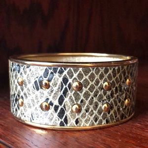 Studded snake print gold tones hinged bracelet